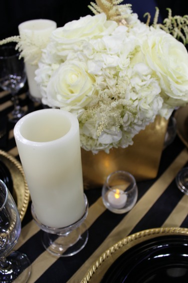 Pillar LED candles, Black and White Table, Black and Gold tables, White floral centerpieces, Hydrangeas, White Roses, Astilbe, Allen Bridal Show, Texas Bridal Show, Best Bridal Show in Texas, Florist at bridal shows, Posh Floral Designs, Black and Gold Tables, White flowers, Unique Centerpieces