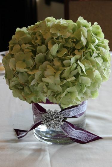 Green Hydrangea centerpieces, brooch on centerpieces, lace and ribbon on centerpieces, centerpiece ideas, wedding centerpiece ideas, posh floral designs, bella donna chapel, Stonebridge country club, new wedding venues in north texas, posh floral designs,