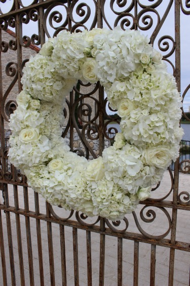 Gate decor, wedding decor on gates, flower wreaths, flower wreath ideas, white wreaths for weddings, wreaths for weddings, wedding wreaths, White hydrangeas, Polo Roses, White Spray Roses, White Carnation, Posh Floral Designs, Bella Donna Chapel, Stonebridge Country Club, Ideas for weddings, New ideas for weddings, Posh floral designs, Angie Strange,