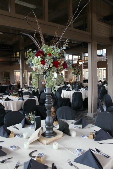 Tall centerpieces, western centerpieces, country centerpieces, feathers in centerpieces, western wedding, country wedding, stockman's club, ft worth stockyards, posh floral designs