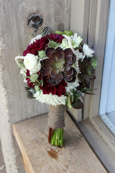 Bridal Bouquets, Unique Bridal Bouquets, Succulents in Bridal Bouquets, Feathers in Bouquets, Pearls in Bouquets, Country Bouquets, Western Bouquets, Stockman's Club, Ft Worth Stockyards, Posh Floral Design, White Ranuculus, white Dalhias, Smoke Bush, Burgundy Dahlias, Red Dalhias