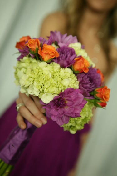 Spring Bouquet is full of color. Purple Dahlias, Lime Hydrangeas, and Orange Spray Roses. Photograhy By Abby Wood Photography