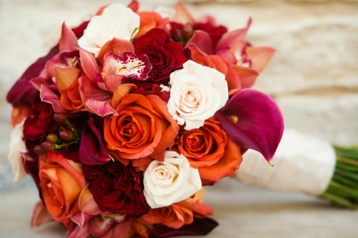 Fall Bouquet with Freedom Roses, Coffee Break Roses, Burgundy Mini Callas, Creamy Spray Roses, and Burgundy Hypericum Berries. Photography By Allison Davis Photography