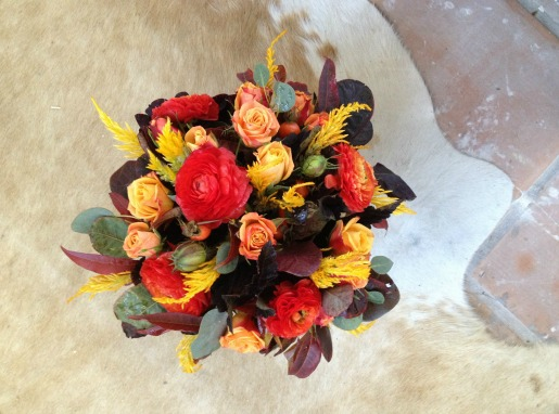 Red Ranuculus, Orange Spray Roses, Smoke Bush, Berries, Fall Foliage, Fall Centerpieces, Thanksgiving Centerpieces, Thanksgiving centerpiece ideas, Wooden Boxes, cowhide rug
