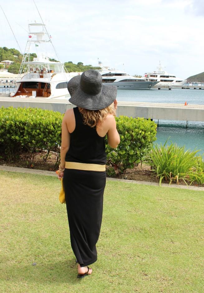 Black Maxi Dress   Black Floppy Hat   Seashell Bracelet   Tory Burch Sandals   Yellow Clutch   Posh Floral Designs